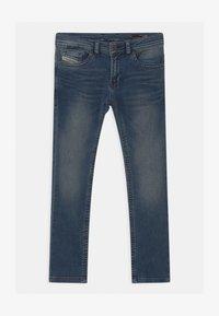Diesel - THOMMER UNISEX - Slim fit jeans - blue denim - 0