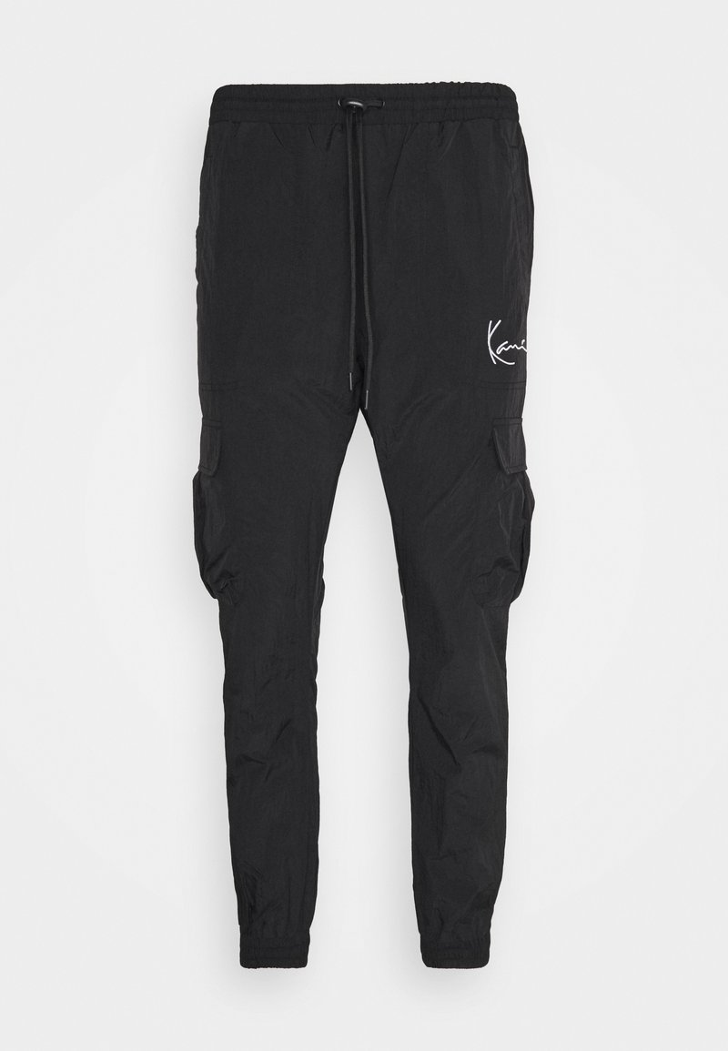 Karl Kani - SIGNATURE TRACKPANTS UNISEX - Tracksuit bottoms - black