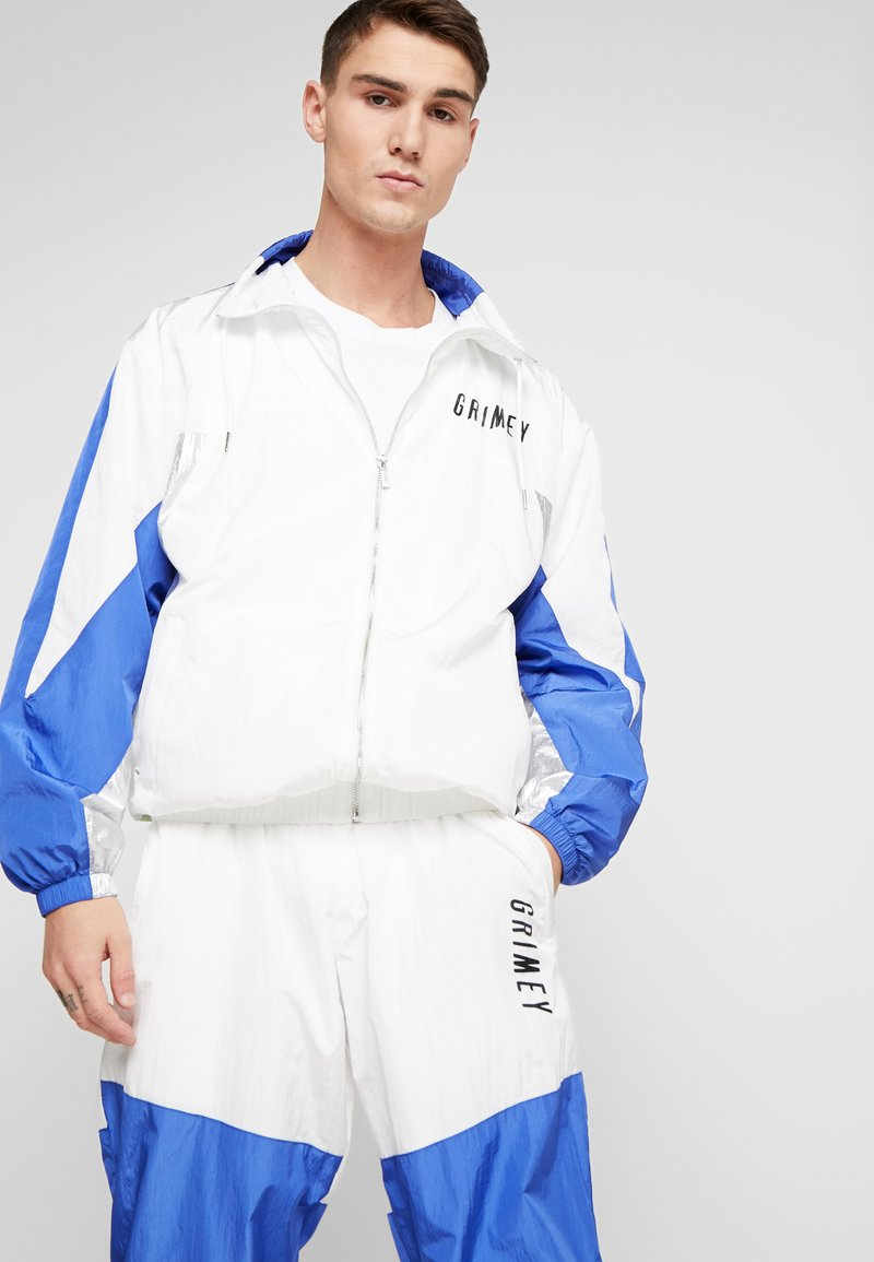 Grimey - PLANETE NOIRE SILVER TRACK JACKET - Träningsjacka - white