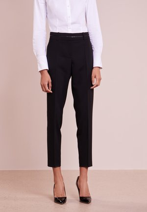 HALUNA - Trousers - black