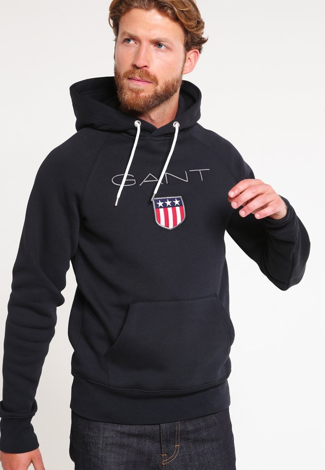 SHIELD HOODIE - Sweat à capuche - black