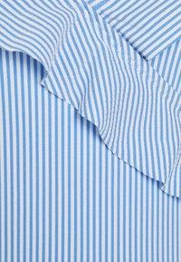 Becksöndergaard - STRIBA FRILL SWIMSUIT - Swimsuit - blue - 2