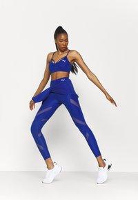 Puma - PAMELA REIF X PUMA MID WAIST LEGGINGS - Leggings - mazerine blue - 3