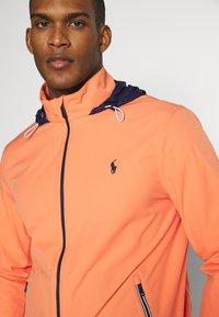 Polo Ralph Lauren Golf - HOOD ANORAK JACKET - Waterproof jacket - true orange - 5