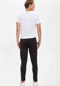 DeFacto Fit - Pantaloni sportivi - black - 2
