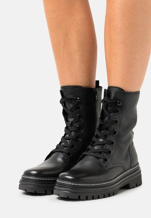 Lace-up ankle boots - schwarz/weiß