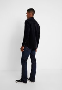 Tommy Jeans - RYAN  - Jeans Bootcut - lake raw stretch - 2