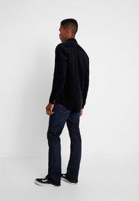 Tommy Jeans - RYAN  - Bootcut jeans - lake raw stretch - 2