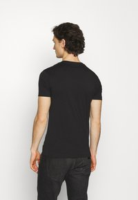 Calvin Klein Jeans - SEASONAL MONOGRAM TEE UNISEX - Print T-shirt - black - 2