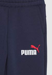 Puma - LOGO PANTS - Tracksuit bottoms - peacoat - 2