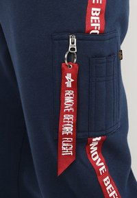 Alpha Industries - JOGGER TAPE - Tracksuit bottoms - new navy - 5