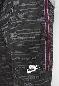 Nike Sportswear - Tracksuit bottoms - black/iron grey - 4