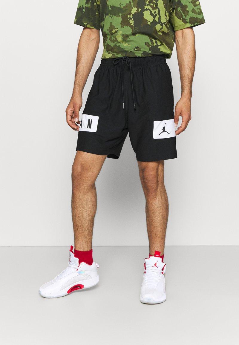 Jordan - AIR - Krótkie spodenki sportowe - black/white