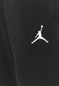 Jordan - AIR PANT - Tracksuit bottoms - black/white - 5