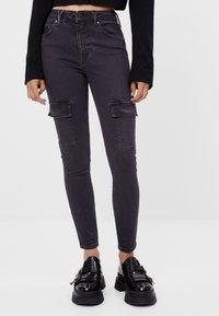 Bershka - Cargo trousers - black - 0