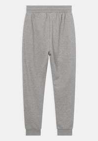 adidas Originals - UNISEX - Tracksuit bottoms - medium grey heather/white - 1