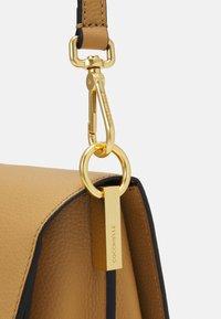 Coccinelle - LOUISE - Handbag - warm beige/noir - 6