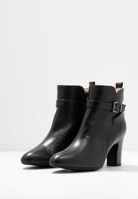 Unisa Wide Fit - UMBRIAWD - Boots à talons - black - 4
