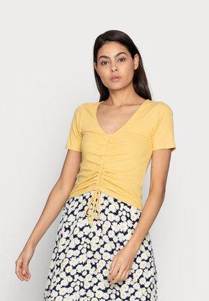 TOP DANIKA - Print T-shirt - light yellow