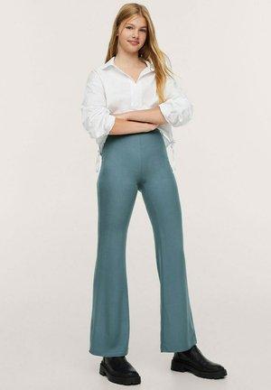 WIJD UITLOPENDE - Trousers - petrol blauw