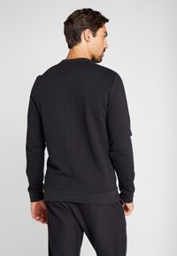 Reebok - ELEMENTS SPORT LONG SLEEVE PULLOVER - Sweatshirt - black - 2