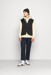adidas Originals - TRAIL VEST - Waistcoat - black - 1