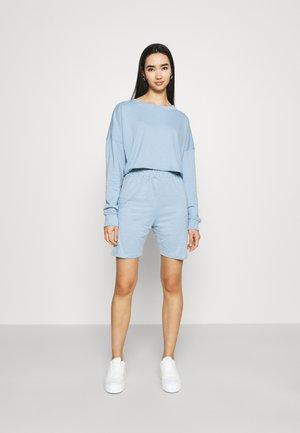 CYCLING SET - Sweatshirt - powder blue