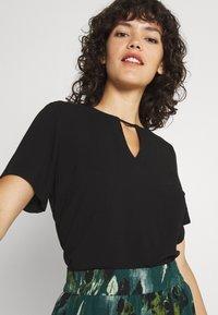 Vila - VILANA KEY HOLE - Basic T-shirt - black - 3