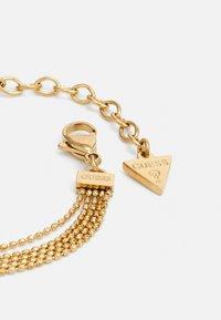 Guess - Bracelet - gold-coloured - 1