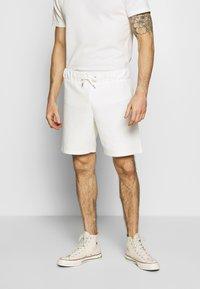 Jack & Jones PREMIUM - JPRFRANCO - Tracksuit bottoms - blanc de blanc - 0