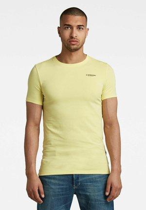 SLIM BASE R - Print T-shirt - dk bleach yellow