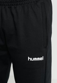 Hummel - HMLGO COTTON PANT - Tracksuit bottoms - black - 4