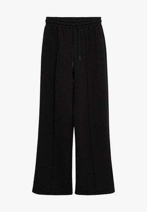 NEOSOFT - Teplákové kalhoty - schwarz