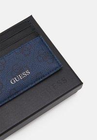 Guess - VEZZOLA CARD CASE UNISEX - Wallet - blue - 3