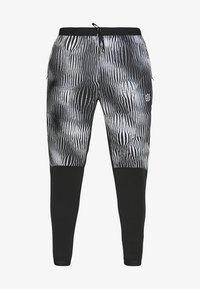 TRK WRM PR FF - Tracksuit bottoms - black/silver