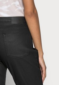 Opus - EVITA COATED - Jeans Skinny Fit - black - 4