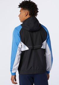 New Balance - NB ATHLETICS  - Summer jacket - faded cobalt - 1