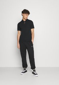 Nike Sportswear - THE SLIM  - Polo shirt - black - 1