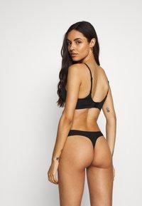 Calvin Klein Underwear - THONG 2 PACK - Thong - black - 2