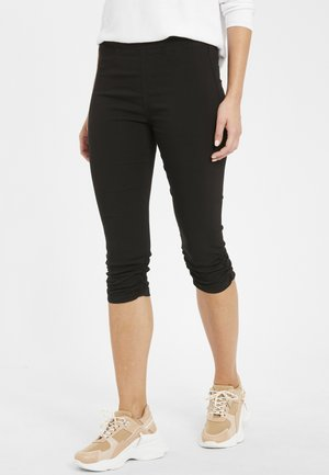 BYKEIRA BYDIXI - Trousers - black