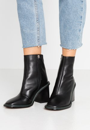 HUGH BOOT - High heeled ankle boots - black