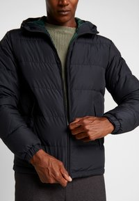Tommy Hilfiger - HOODED REDOWN BOMBER - Down jacket - black - 4