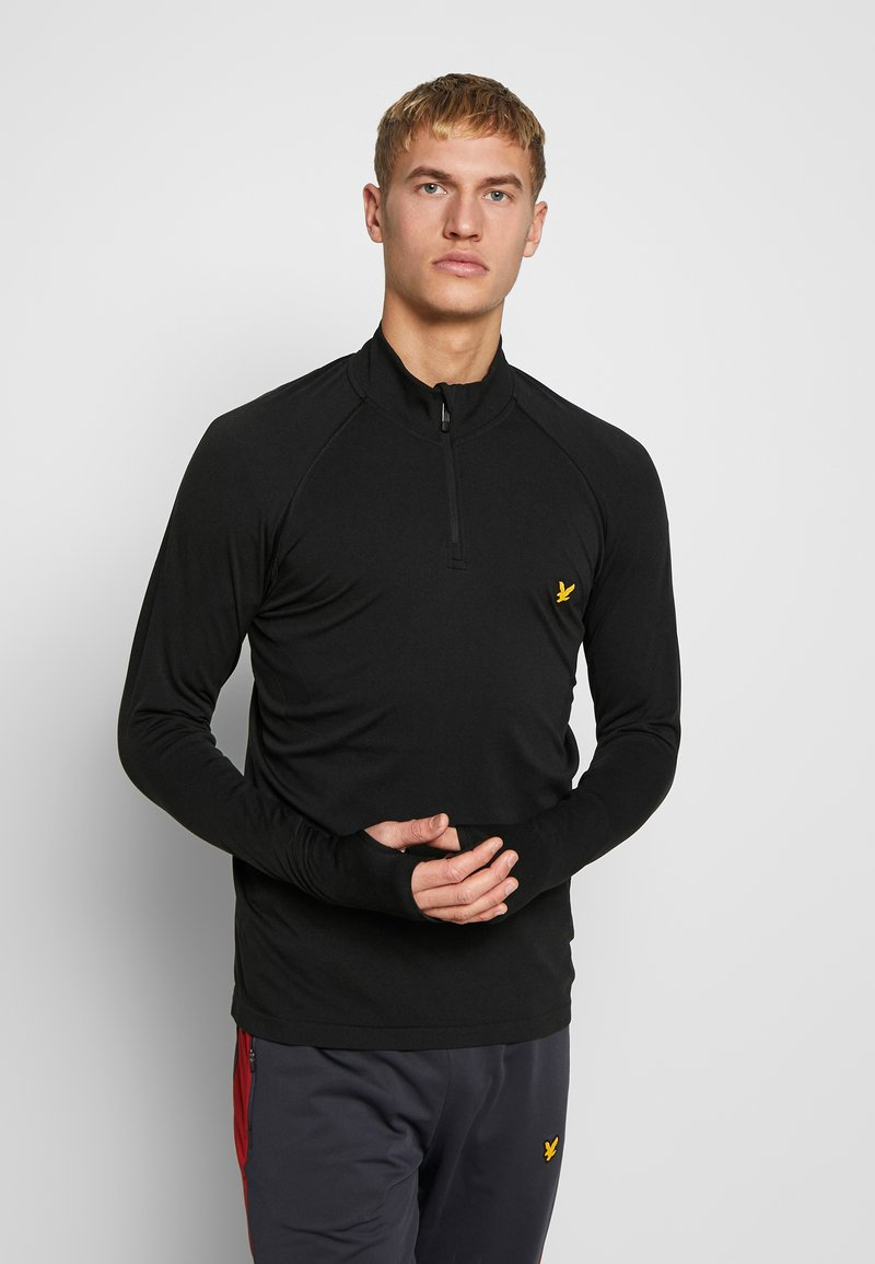 Lyle & Scott - PERFORMANCE SEAMLESS MIDLAYER - Sports shirt - true black marl