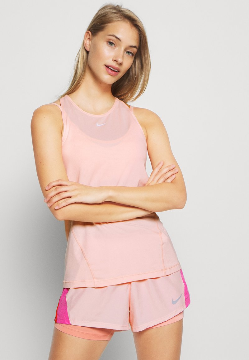 Nike Performance - TANK ALL OVER  - Camiseta de deporte - washed coral
