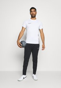 Nike Performance - ACADEMY PANT WINTERIZED - Träningsbyxor - black/volt - 1