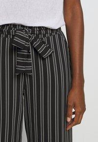 Cartoon - Trousers - black/white - 5