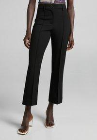Bershka - Spodnie materiałowe - black - 3