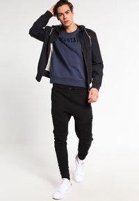 Urban Classics - Pantaloni sportivi - black - 1
