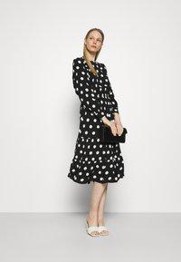 Marks & Spencer London - SPOT VOLUME MIDI - Day dress - black - 1
