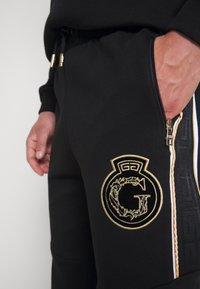 Glorious Gangsta - RAYLOW JOGGER - Tracksuit bottoms - jet black/gold - 5